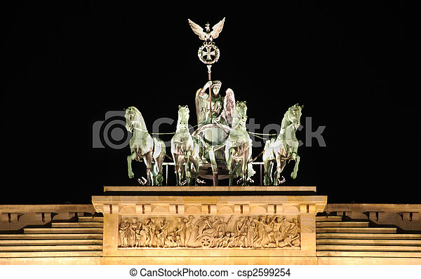 berlin brandenburg gate by night with the quadriga sculpture - csp2599254