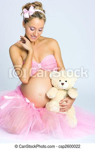 Pregnant girl with teddy bear - csp2600022