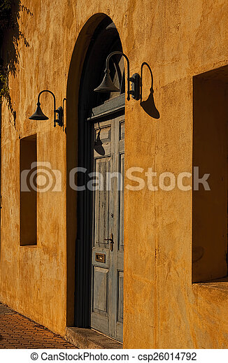 Weathered Blue Door in a Yellow Wall