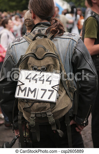 Man with number from car on back. Not real number.