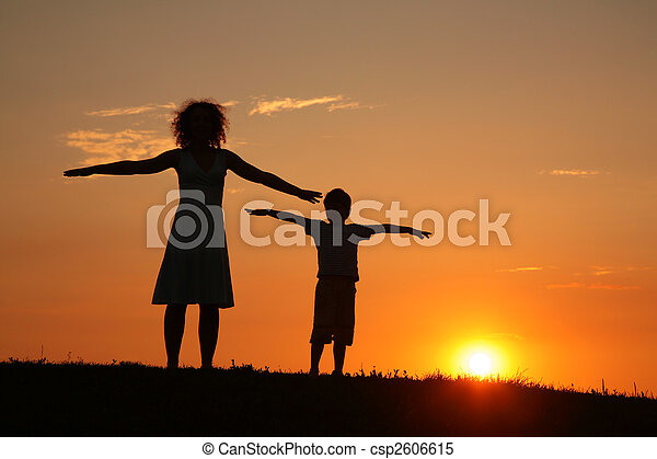 Mother and son on sunset stretching - csp2606615