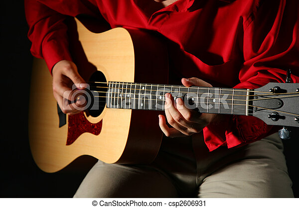 Close-up hands with guitar - csp2606931