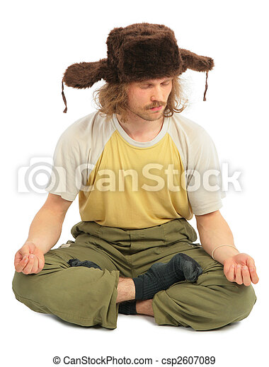meditating long-haired Russian man in cap with ear-flaps - csp2607089