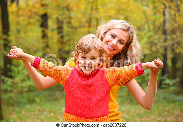 Mother and child in autumn forest - csp2607226