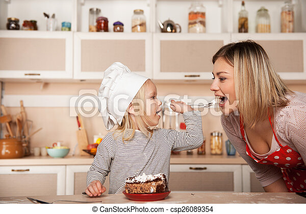 Little Cute Girl Feeding Her Mother Cake Kitchen Interior Concept For Young Kitchen Hands Stock Images Page Everypixel