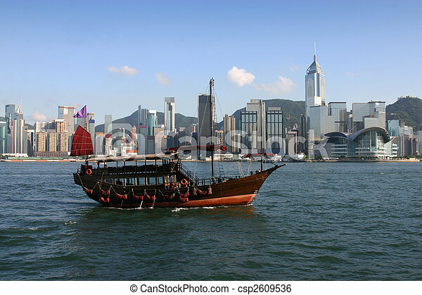 View across Victoria Harbour complete with traditional Chinese junk in the foreground. - csp2609536