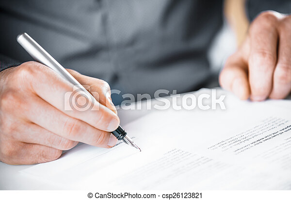 Man signing a contract or agreement