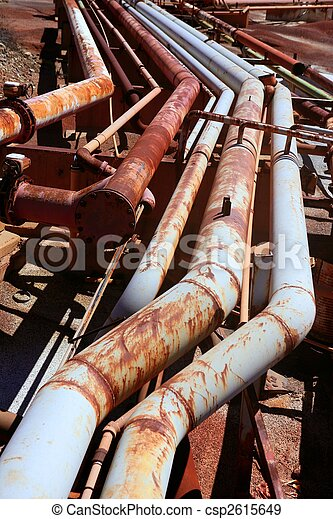 Aged rusty grunge industrial pipe lines - csp2615649