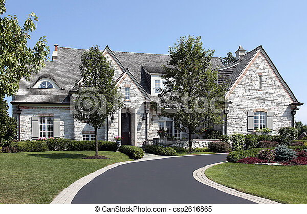 Luxury stone home with circular driveway - csp2616865