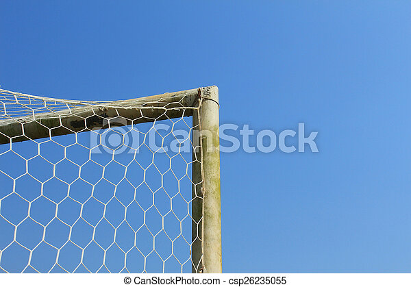 Old soccer goal with blue sky - csp26235055
