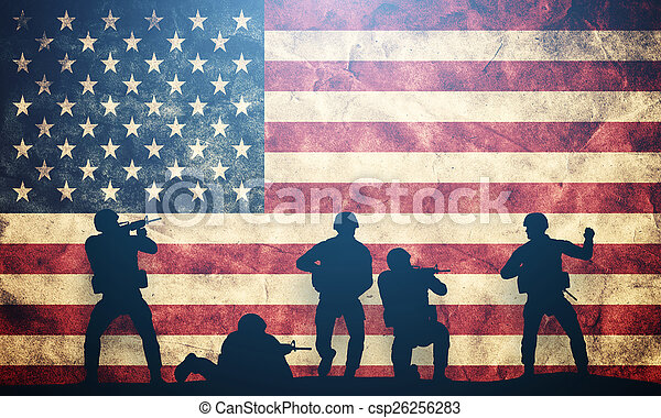 Soldiers in assault on USA flag. American army, military concept. - csp26256283