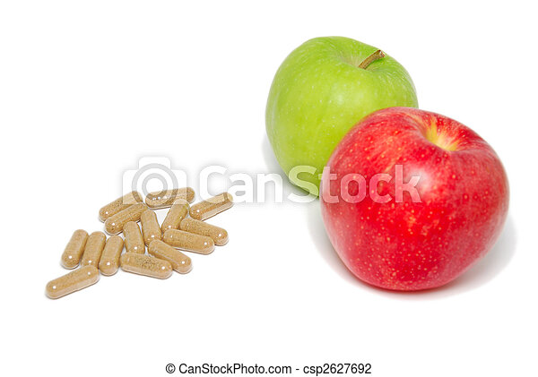Contrast of apples and medical capsules - csp2627692