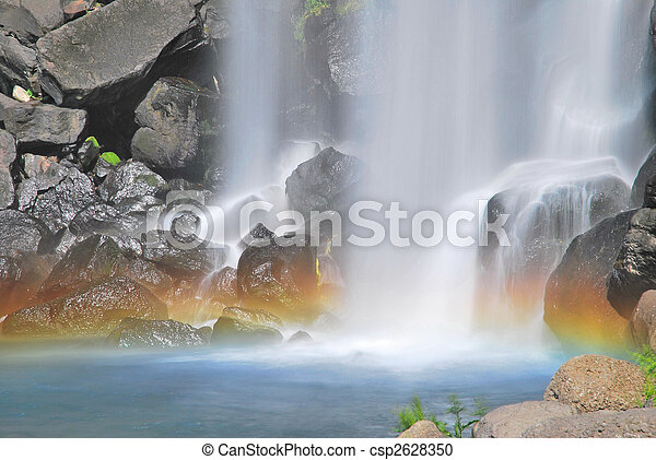 Majestic waterfall with colorful rainbow - csp2628350