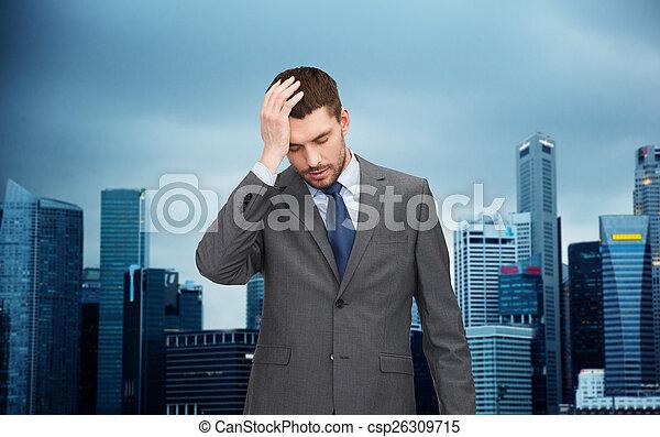 young businessman having headache