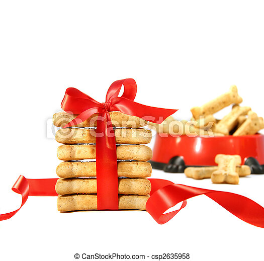 Dog biscuits wrapped with red bow  - csp2635958