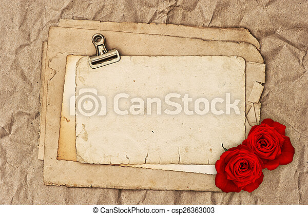 old blank paper and two rose flowers