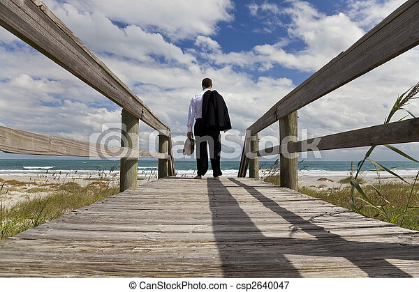 Businessman Standing Barefoot Looking Across A Beach To The Sea - csp2640047
