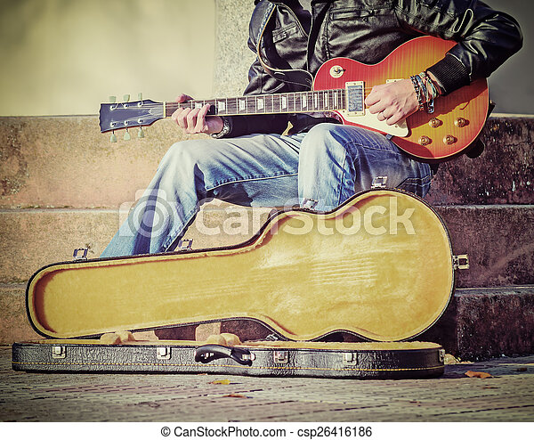 guitar player with open guitar case in vintage tone