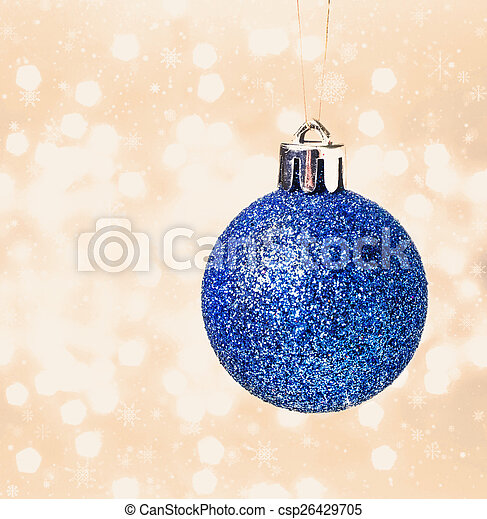 Christmas card with blue hanging ball on Defocused gold Christm