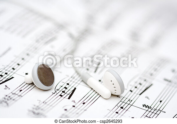 Stock Photos of Music - White earbuds on book of musical notes