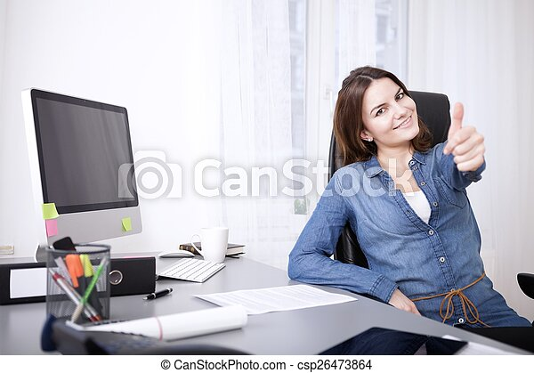 Smiling successful woman giving a thumbs up