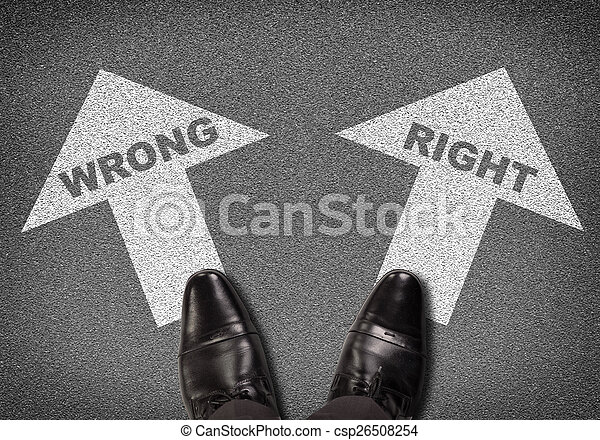 Shoes standing on asphalt road with two arrows. Labels wrong and right