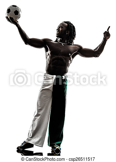 black man soccer player holding showing football  silhouette - csp26511517