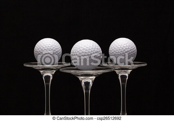 Three glasses of champagne and golf balls - csp26512692