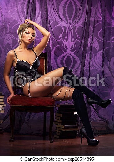 Young attractive woman in sexy lingerie posing in luxury interior - csp26514895