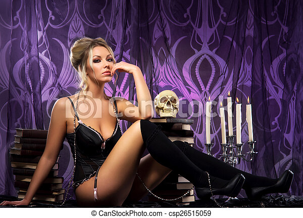 Young attractive woman in sexy lingerie posing in gothic interior - csp26515059