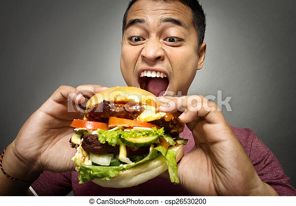 Young Man have a great desire to eat a burger