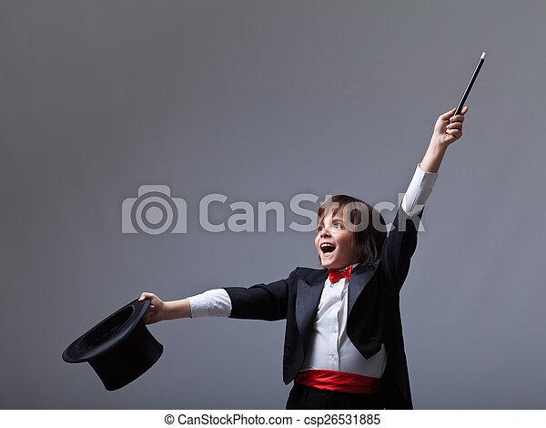 Young magician performing a trick