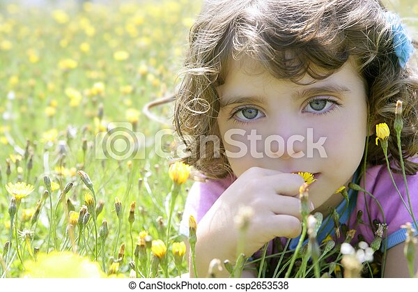Adorable little girl smell flower in meadow - csp2653538