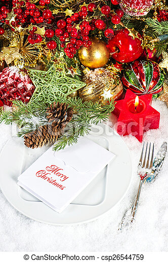 christmas table place setting. candle light dinner