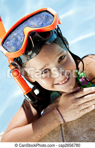 Happy Girl In A Swimming Pool with Goggles and Snorkel - csp2656780