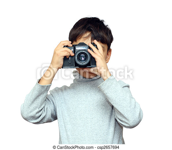 boy photographing with black slr camera - csp2657694