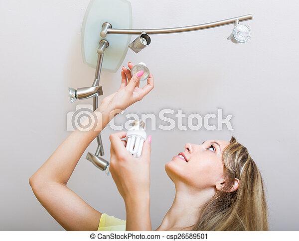 Housewife changing light bulbs