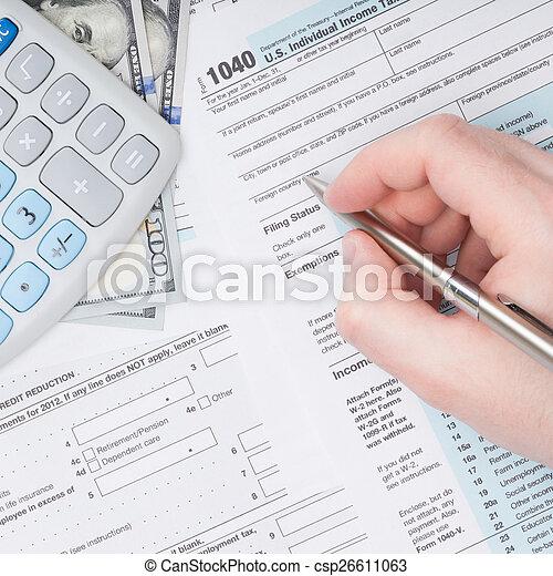 Filling out U.S. 1040 Tax Form - close up studio shot