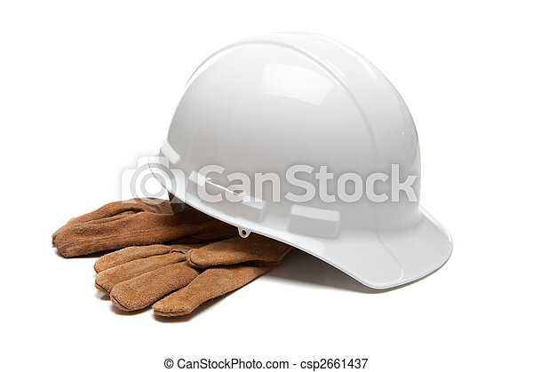 White hard hat and leather work gloves on white - csp2661437