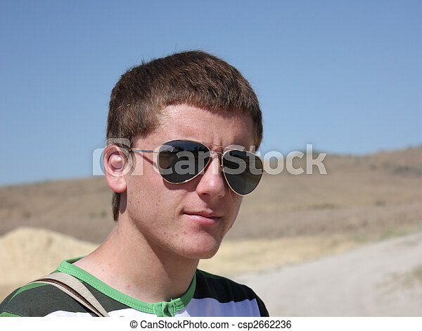 Young boy smiling with eyeglasses - horizontal - csp2662236