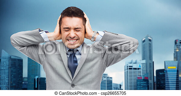 businessman in suit having head ache