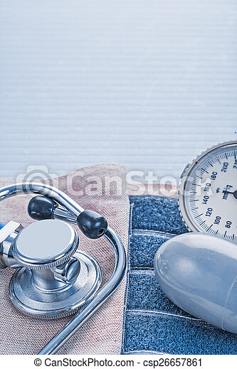 stethoscope and blood pressure monitor on blue background medica - csp26657861