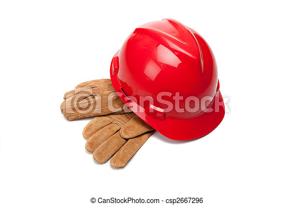 Red hard hat and leather work gloves on white - csp2667296