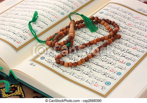 Holy Quran with wooden rosary - csp2668390