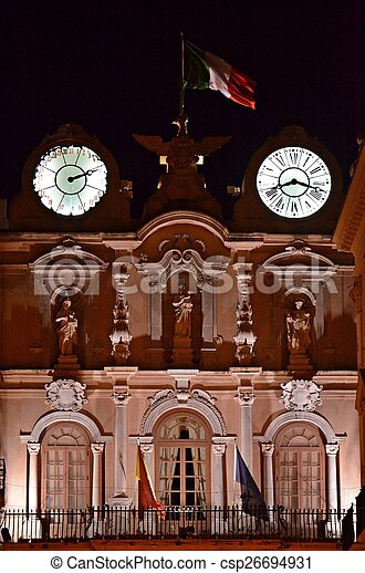 old house with clock at night