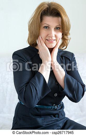 Beautiful pensive woman in  blue dress - csp26717945