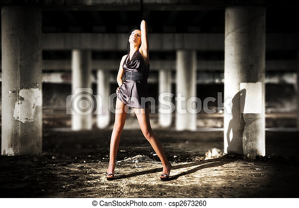 Sexy woman posing in dark industrial zone - csp2673260