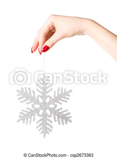 Woman hand holding big holiday snowflake - csp2673363