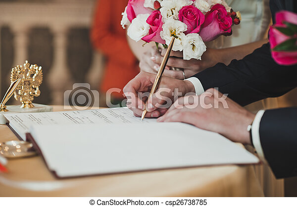 The businessman signs paper the handle.