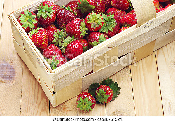 Strawberries in a basket and near